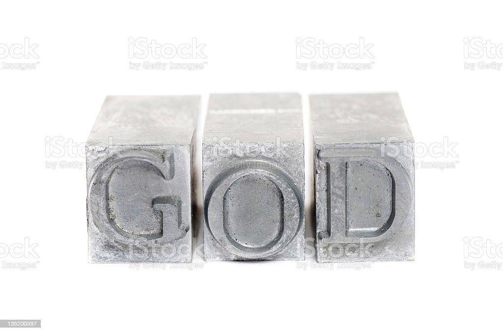 Silver square typewriter letters that spell GOD. royalty-free stock photo