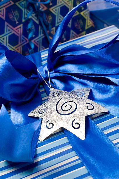 Silver star blue ribbon gift stock photo