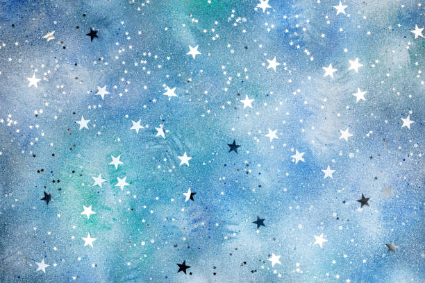 silver stars confetti on blue background with colorful blots stock photo