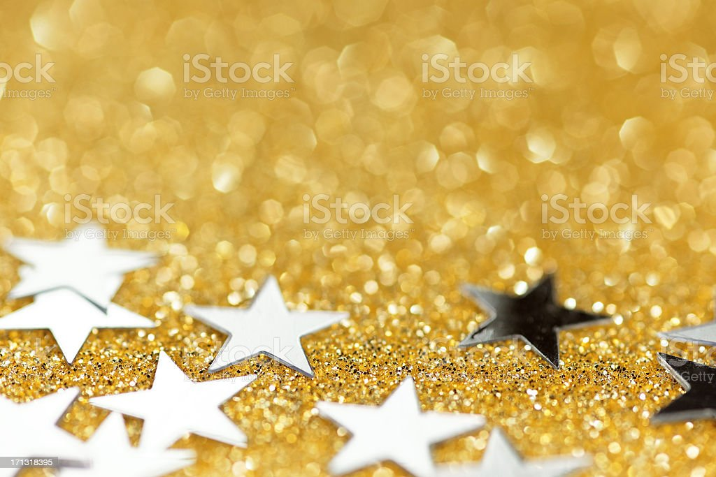 silver stars on golden glittering background royalty-free stock photo