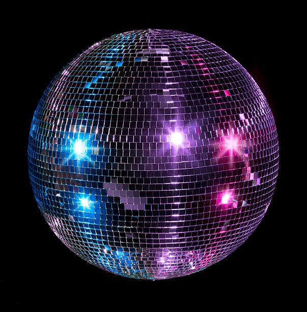 A silver suspended glitter ball A blue purple and pink lit disco ball isolated on a black background. disco ball stock pictures, royalty-free photos & images