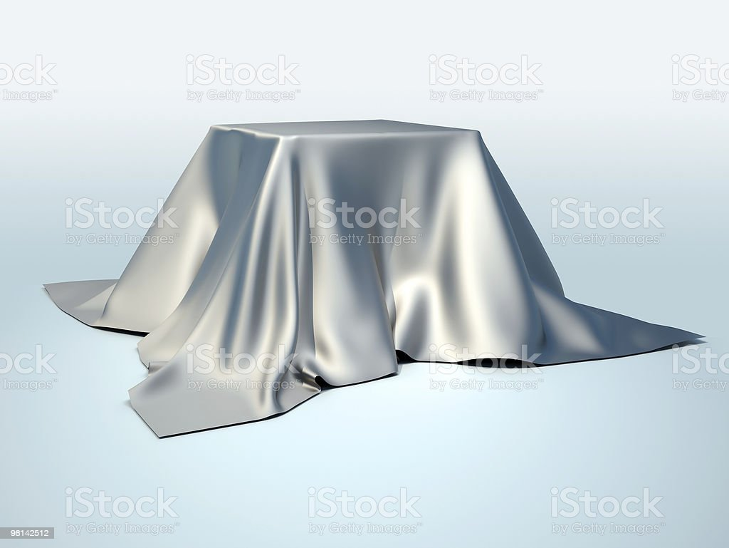 Silver tablecloth on blue background royalty-free stock photo