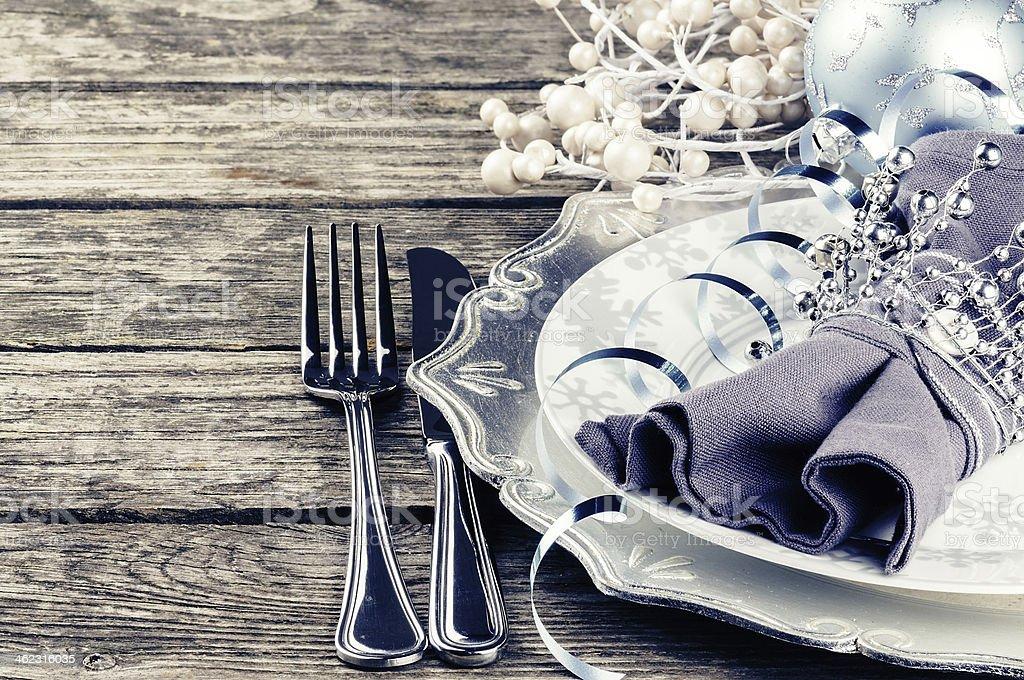 A silver theme Christmas table setting stock photo