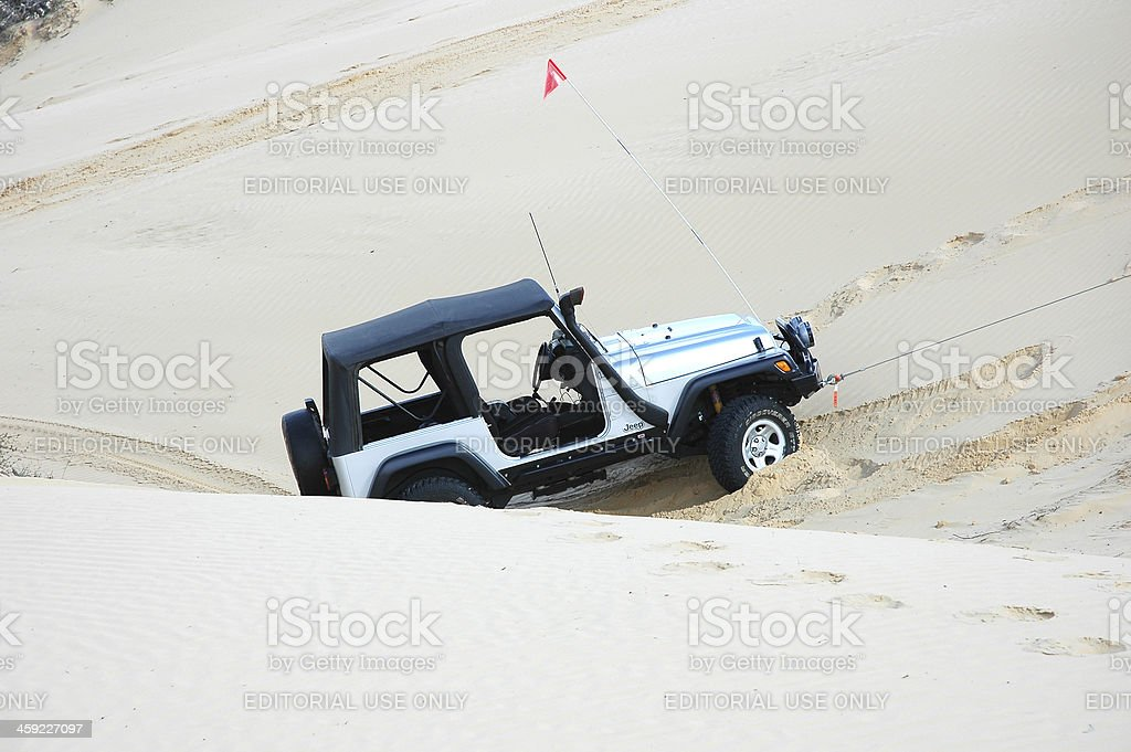 Silver TJ Jeep Wrangler driving in sand dunes, South Australia stock photo