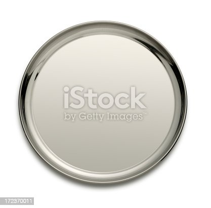 A round silver tray isolated on a white background. A light gray tone across the serving tray allows ample room for copy. A soft shadow sits under the tray.