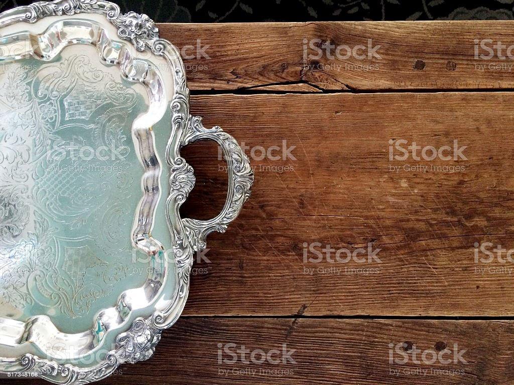 Silver Tray on a Wood Countertop stock photo
