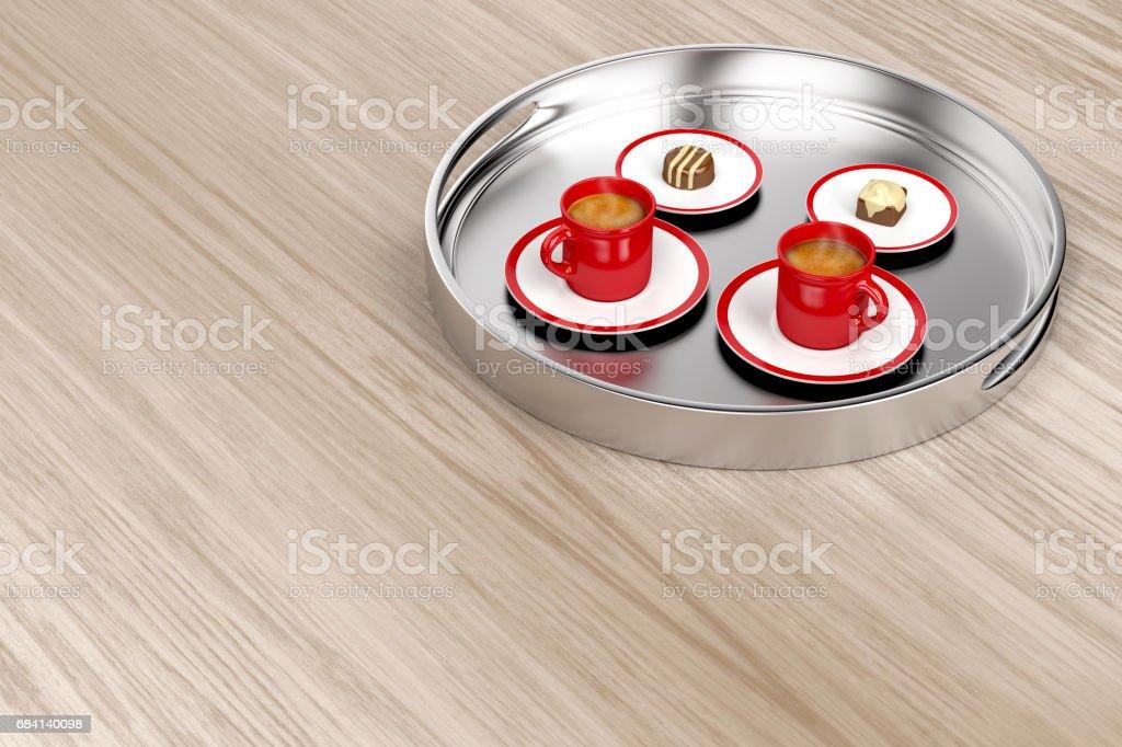 Silver tray with coffee and chocolate candies royaltyfri bildbanksbilder