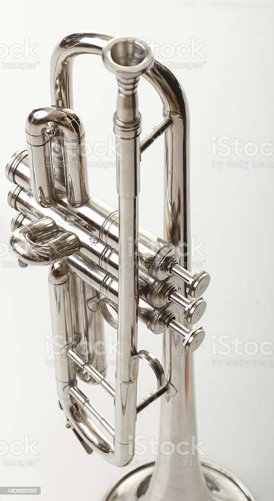 silver trumpet on a white background royalty-free stock photo