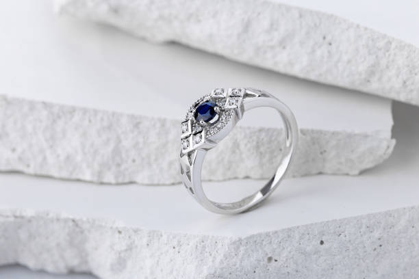 Silver wedding ring decorated with sapphire and diamonds