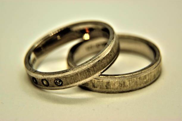 silver wedding rings on a white background stock photo