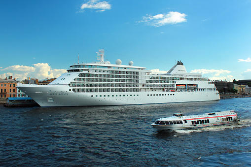Silver Whisper cruise ship at Saint Petersburg's English Embankment pier on Neva river.
