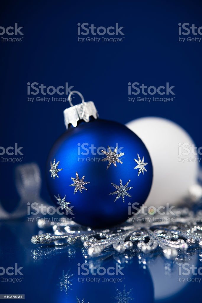 silver white and blue christmas ornaments on dark blue background royalty free stock photo
