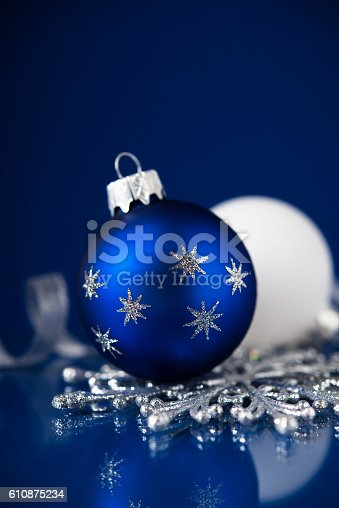 silver white and blue christmas ornaments on dark blue background stock photo more pictures of backgrounds istock - Navy Blue Christmas Decorations