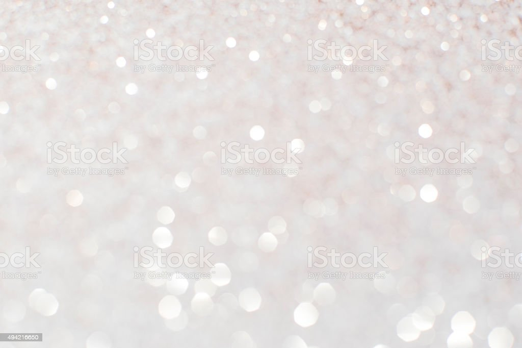 Silver white glittering Christmas lights. Blurred abstract backg stock photo