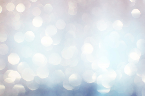istock Silver white glittering Christmas lights. Blurred abstract backg 494347468