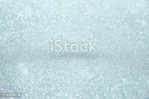 866754590istockphoto Silver white glittering Christmas lights. 1141676774