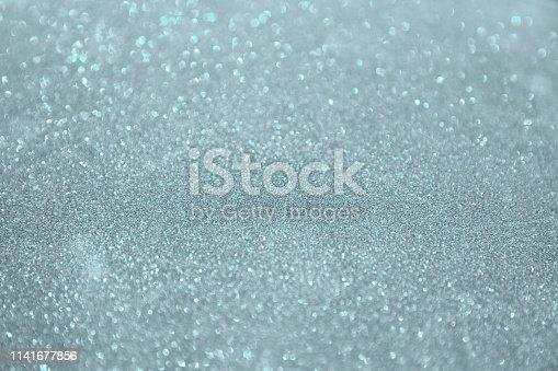 866754590istockphoto Silver white glittering Christmas lights. 1141677856
