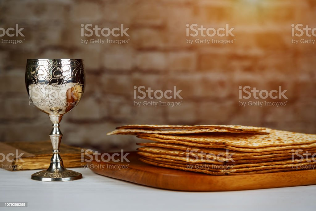 Silver wine cup with matzah, Jewish symbols for the Passover Pesach holiday. Passover concept. stock photo