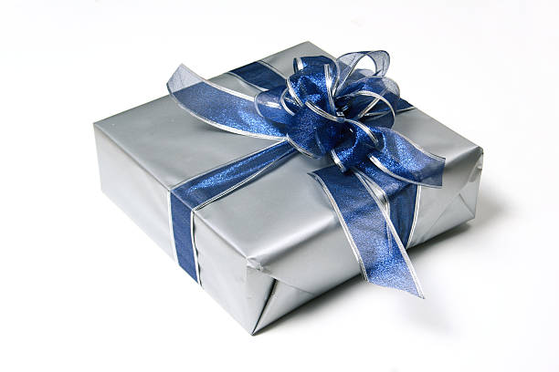 silver wrapped present with blue ribbon stock photo
