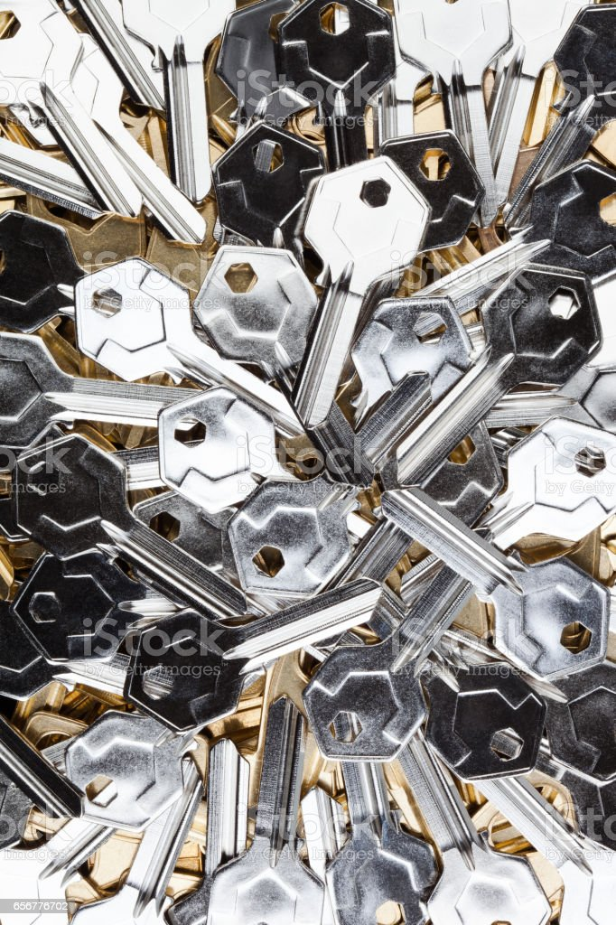 Silver-gold colored key blanks. stock photo