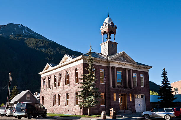 Silverton City Hall Silverton is the county seat and the only incorporated municipality in San Juan County, Colorado, USA. The town is a former silver mining camp, which is now included in a federally designated National Historic Landmark District. Silverton no longer has any active mines and now thrives mainly on tourism. The town is linked to nearby Durango by the Durango and Silverton Narrow Gauge Railroad. At 9,318 feet above sea level, Silverton is one of the highest towns in the country. This picture is of the historic Silverton City Hall and bell tower. san juan county colorado stock pictures, royalty-free photos & images
