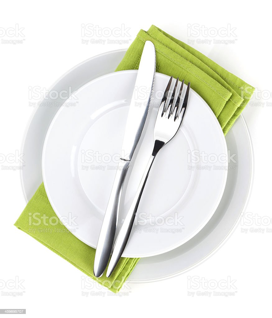 Silverware and napkins on plates stock photo