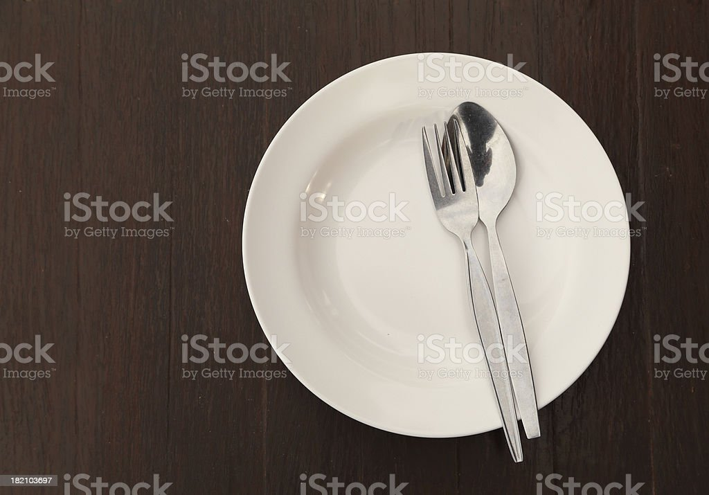 Silverware and plate on table royalty-free stock photo