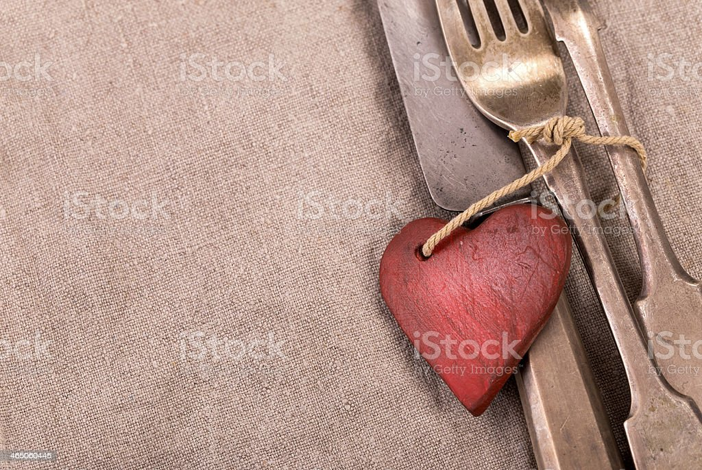 Silverware and red wooden heart stock photo