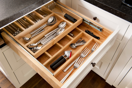 Kitchen silverware drawer with compartments.