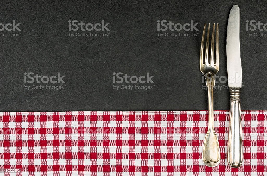 Silverware on a slate plate stock photo
