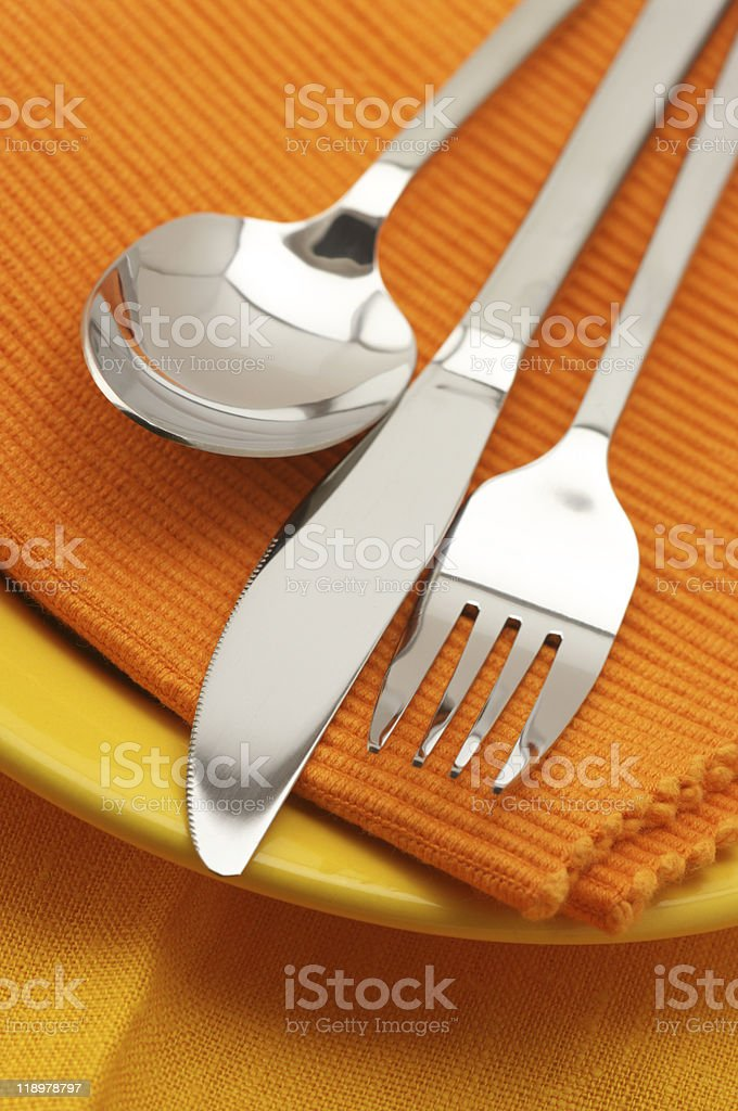 Silverware on plate royalty-free stock photo