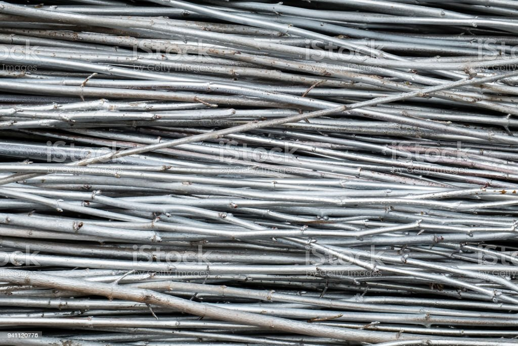 Silvery densely folded branches of trees stock photo