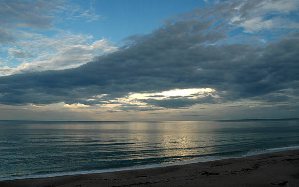 Silvery evening light on the ocean at Florida beach stock photo