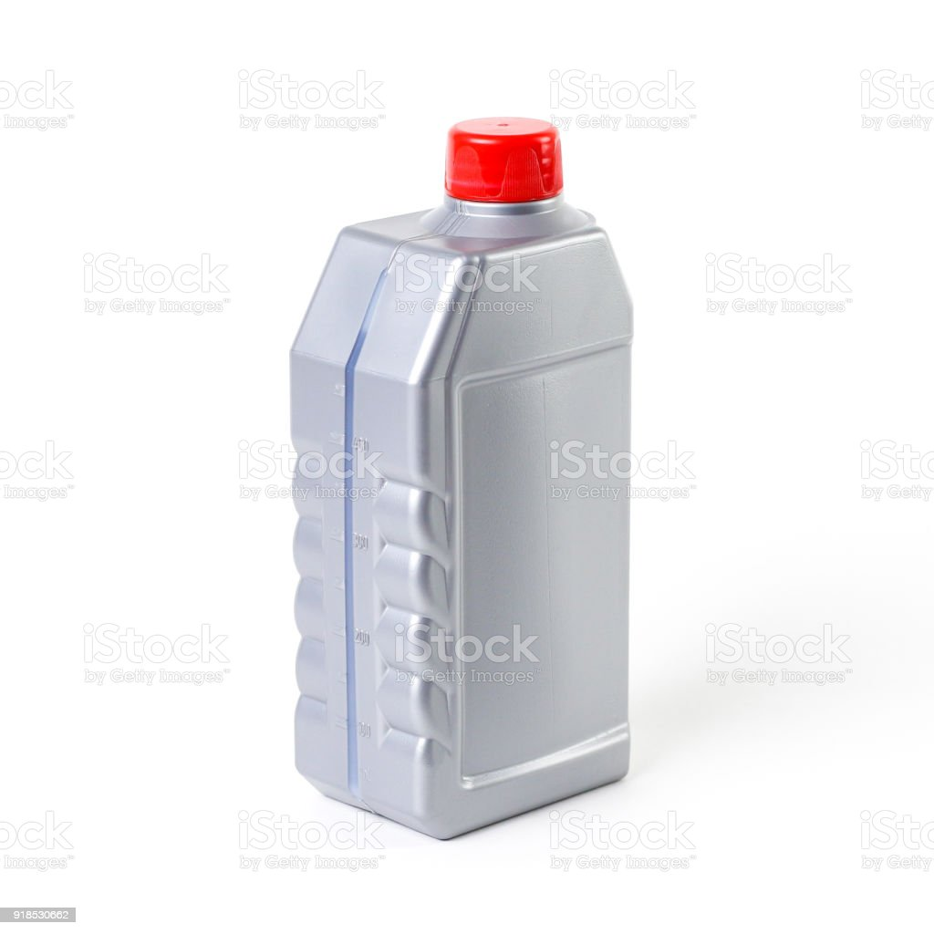 Silvery measuring bottle with red lid. Brake fluid stock photo