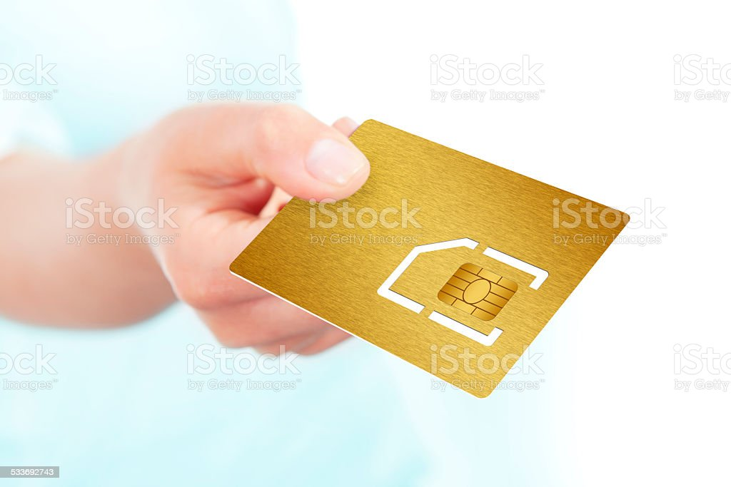 sim card holded by hand over white stock photo