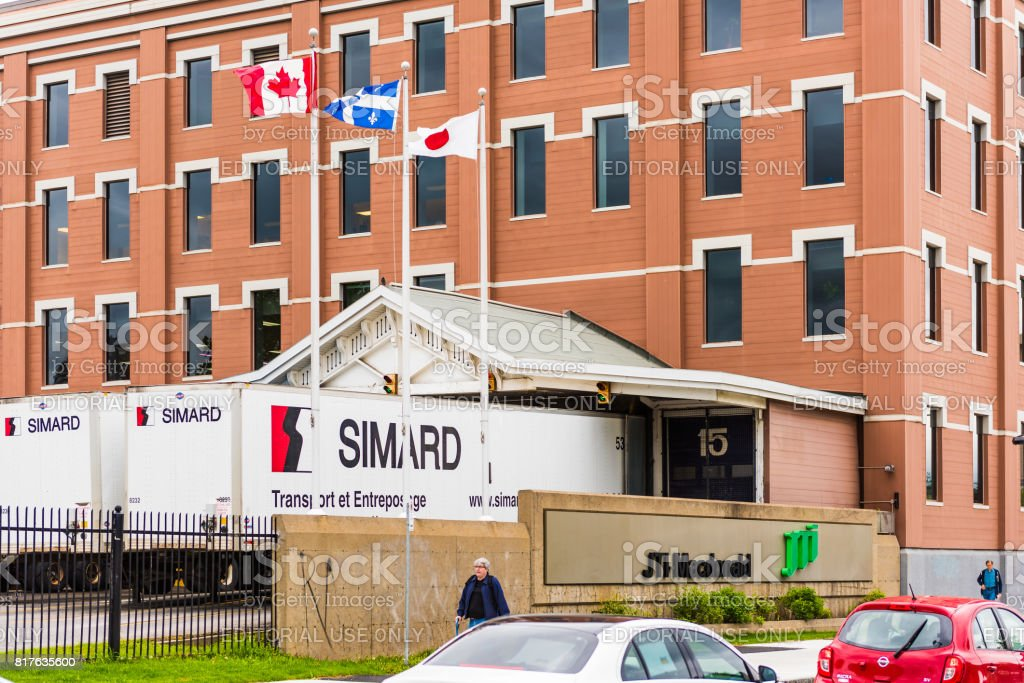 Simard truck parking lot garage in Quebec region city with JTI Macdonald sign stock photo