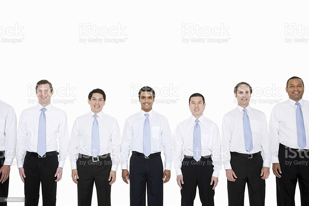 Similar looking businessmen in a row stock photo
