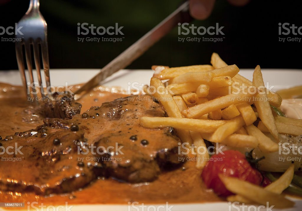 Simmenthal rib-eye steak with green pepper sauce stock photo