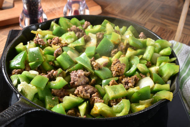 Simmering food in a skillet stock photo