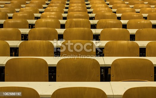 istock Simmetrical Chairs Lines in College Classroom. University, school environment 1062686192