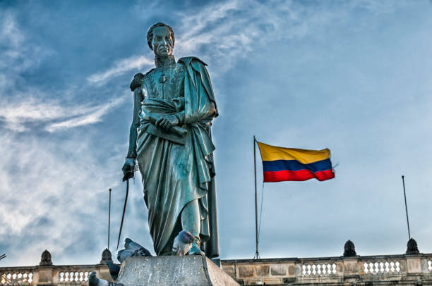simon bolivar statue and colombian flag - colombia stock photos and pictures