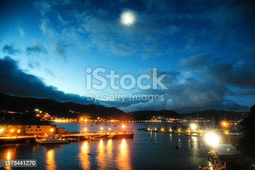 Simon's town port at twilight with full moon and illuminated piers