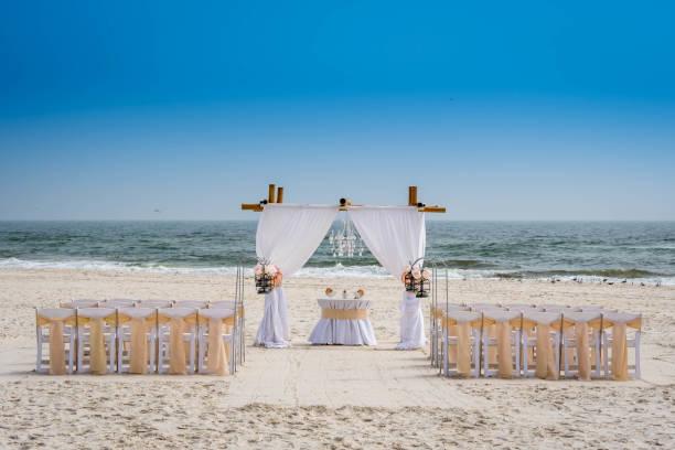 A simple beach wedding arch in Gulf Shores, Alabama stock photo