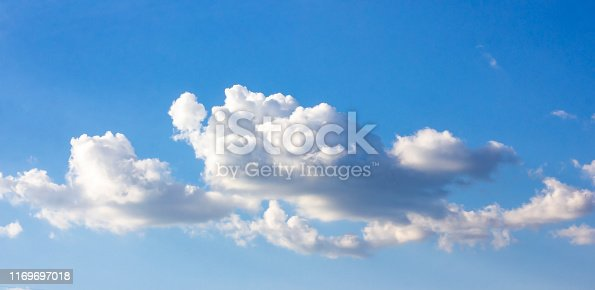 Simple beautiful gloomy blue sky with fluffy clouds in summer morning peace day as a background. Gray, white and turquoise color blurred skyline texture photography