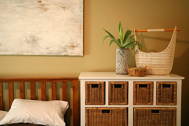 Simple bedroom decor with brown baskets stock photo