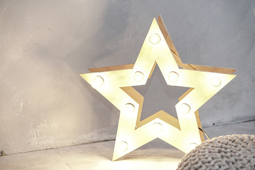 Simple composition with a star that glows. New Year theme