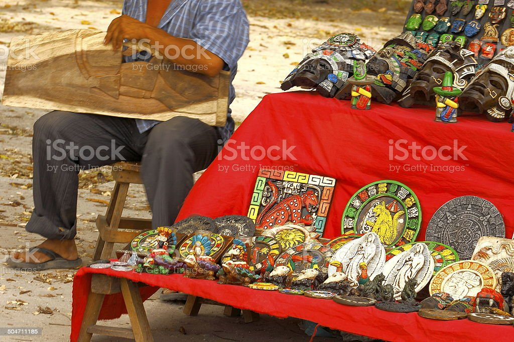 Simple Craftsmen carving Mexican souvenirs in Chichen Itza stock photo