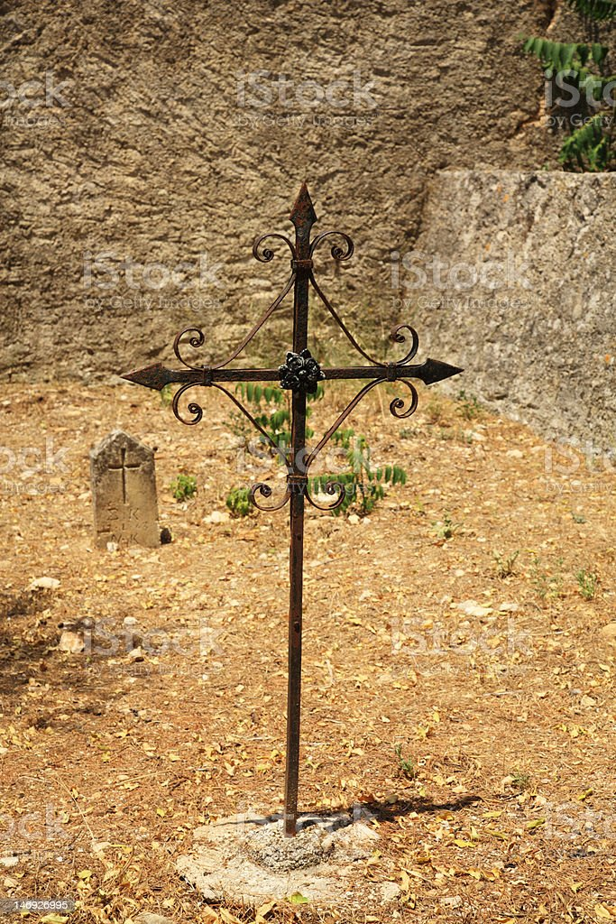 Simple cross in an Old Mycenaean Cemetery royalty-free stock photo