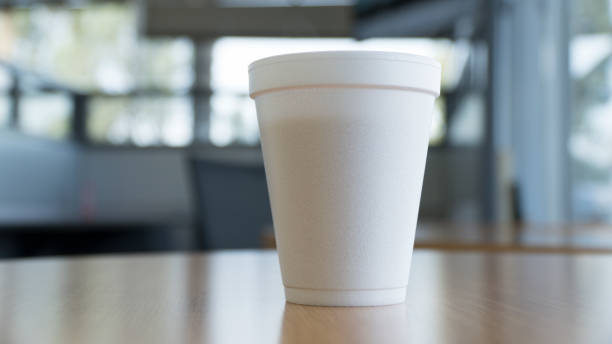 simple cup of coffee simple coffee cup on a table in open space polystyrene stock pictures, royalty-free photos & images