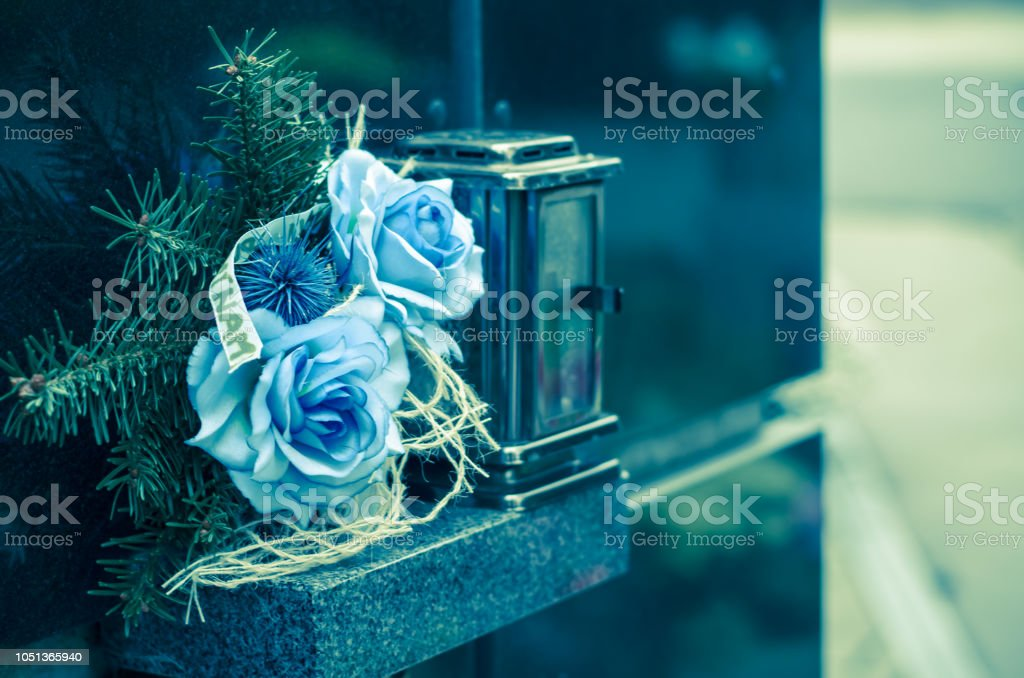 blue flowers decoration during All Saints Day at cemetery